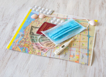 medical-mask-map-pills-passport-money-are-laid-out-table-travel-concept_158388-2627